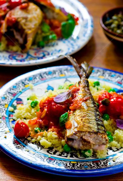 fried mackerel with tomato sauce and couscous  Stock photo © zoryanchik
