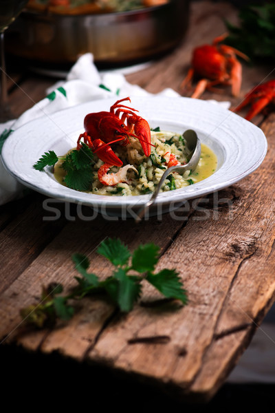risotto with nettles and crayfish.style rustic. Stock photo © zoryanchik