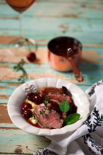 Duck breast with cherry sauce and polenta.style rustic Stock photo © zoryanchik
