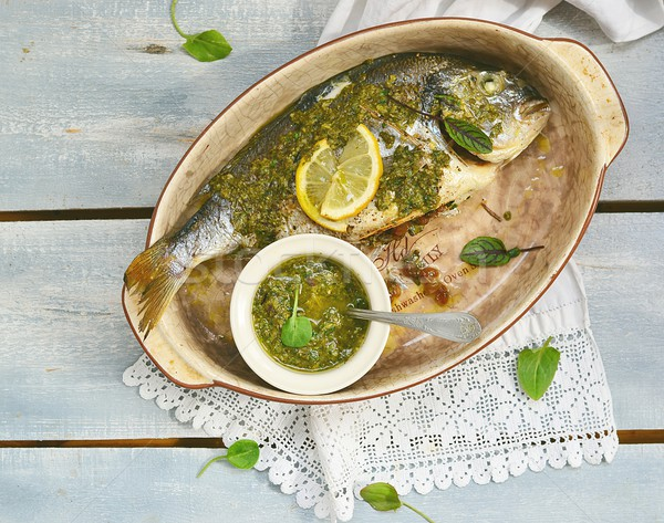 baked dorado fish  with pesto sauce Stock photo © zoryanchik