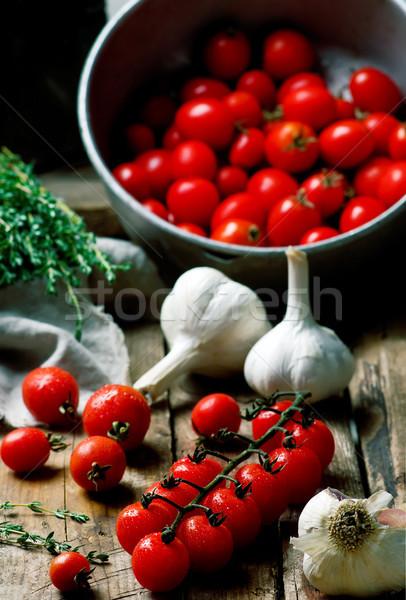 Fresh, organic cherry tomato on the wooden table. Stock photo © zoryanchik