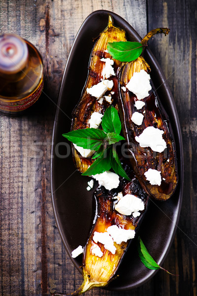 the baked eggplants with cheese and sauce Stock photo © zoryanchik