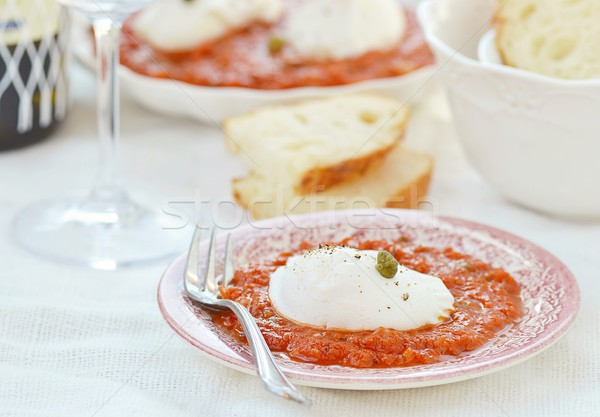 poached egg with tomato sause Stock photo © zoryanchik