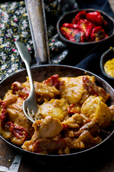 Braised chicken with dried tomatoes in frying pan Stock photo © zoryanchik