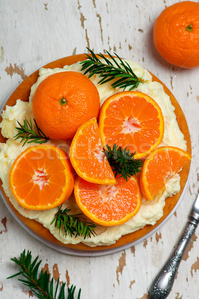 fresh tangerine cake with cream cheese frosting. Stock photo © zoryanchik