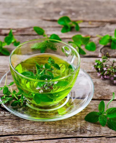 Chá medicinal orgânico ervas vidro copo mesa de madeira Foto stock © zoryanchik