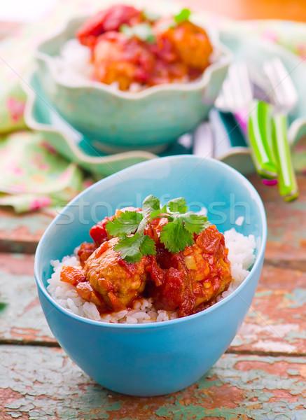 meat balls in tomato sauce and rice.  Stock photo © zoryanchik