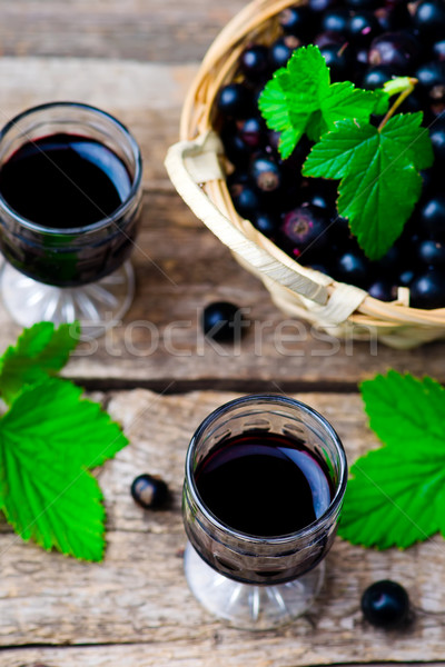 Stock photo: liqueur from blackcurrant in a shot glass