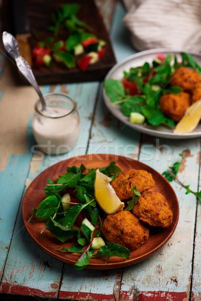 Beet falafel with tahina sauce and green salad  Stock photo © zoryanchik