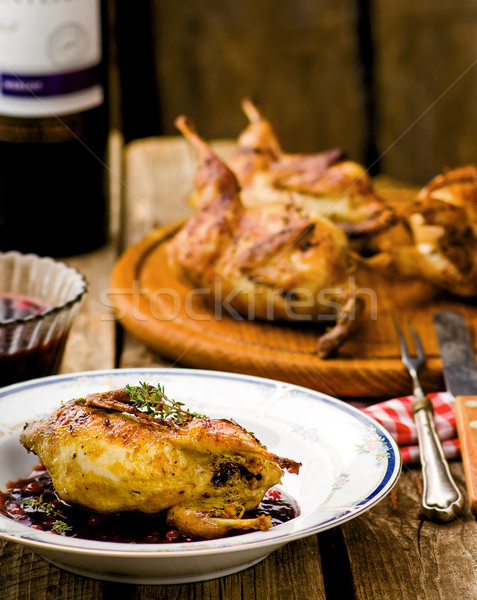 the baked quails with cowberry sauce Stock photo © zoryanchik