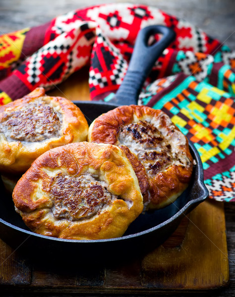belyash ,yeast dough round pasty with meat filling . Stock photo © zoryanchik