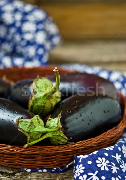fresh, organic eggplants in a wattled basket  Stock photo © zoryanchik