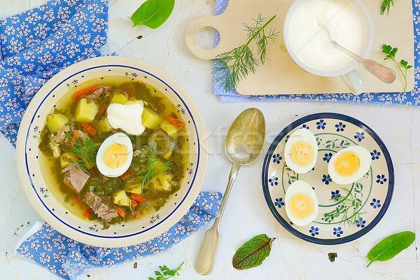 Sorrel  egg and sour cream soup . Stock photo © zoryanchik