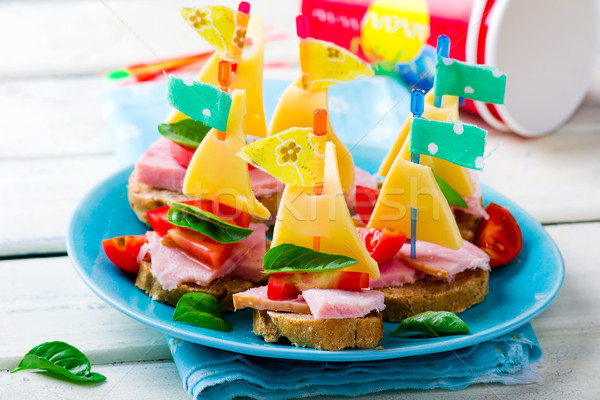 ham and cheese sandwiches in the form of ships  Stock photo © zoryanchik