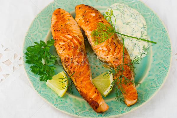 fried fillet of a salmon with sauce  Stock photo © zoryanchik