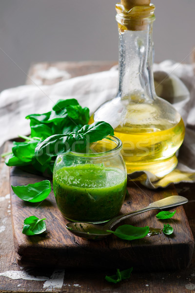 BASIL VINAIGRETTE in glass jar. rustic style.  Stock photo © zoryanchik
