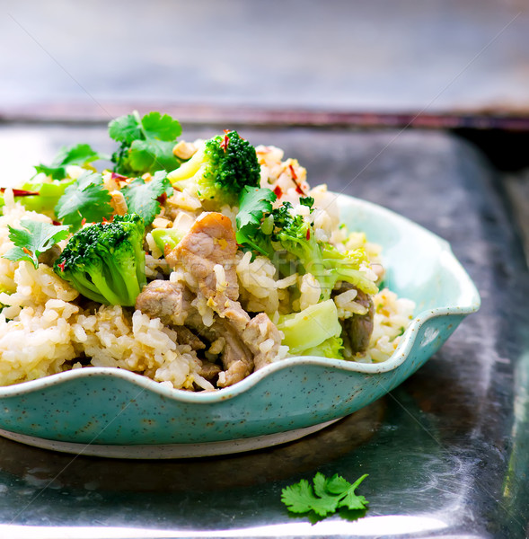 fried rice with pork, vegetables and eggs.  Stock photo © zoryanchik