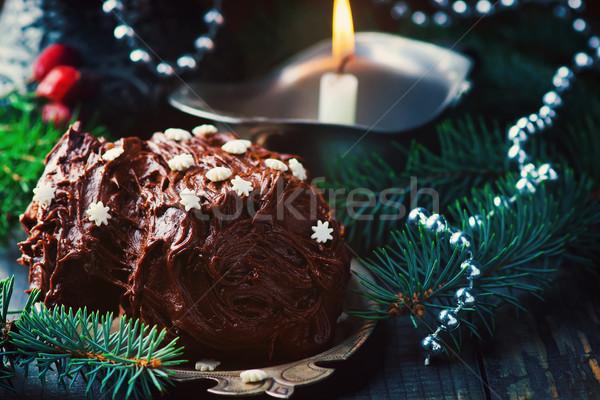 Yule log on a Christmas background. Stock photo © zoryanchik
