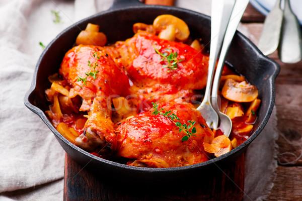 Marengo chicken in a frying pan. . selective focus Stock photo © zoryanchik