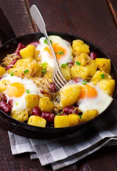 Cheesy Bacon And Egg Hash Stock photo © zoryanchik