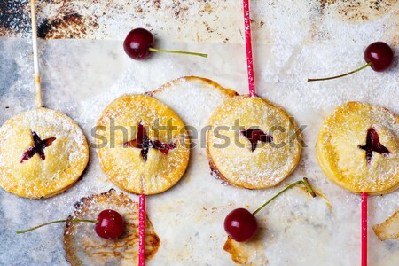 plum pudding with fresh plums and ginger on it is blue to a plate Stock photo © zoryanchik