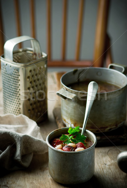 Sopa de frijol salchichas metal taza estilo rústico Foto stock © zoryanchik