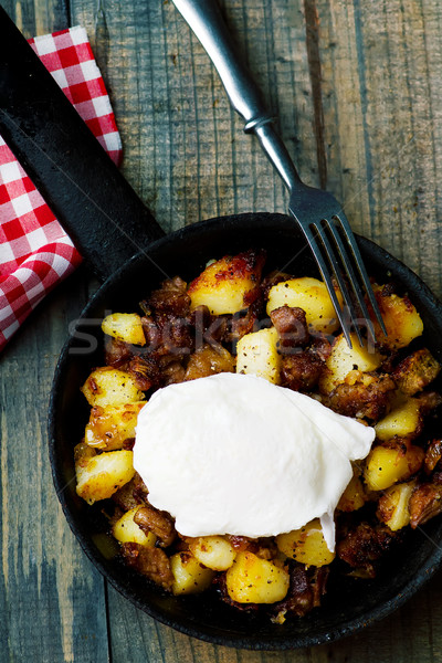 Hash brown in a frying pan. top view Stock photo © zoryanchik