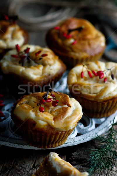 PUMPKIN CREAM CHEESE SWIRL MUFFINS. Stock photo © zoryanchik