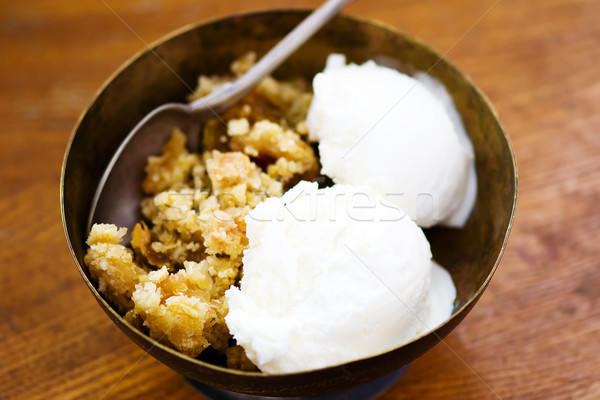 Crumble  from a rhubarb with ice cream. Stock photo © zoryanchik