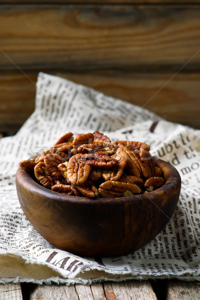 a pecan is in a wooden bowl. style rustic  Stock photo © zoryanchik