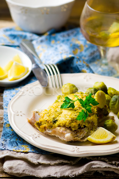 The baked fish fillet with brussel cabbage Stock photo © zoryanchik