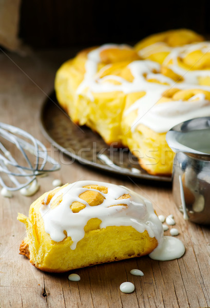 Stock photo: cinnamon roll with pumpkin and glaze