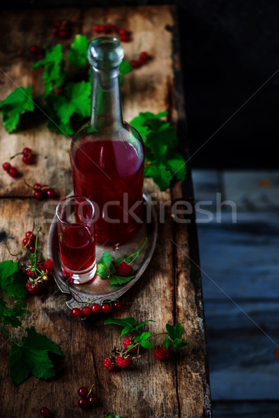 red currant homemade liquor.style vintage. selective focus Stock photo © zoryanchik