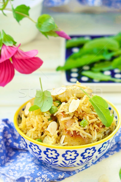 pilaf with chicken, peas and almonds Stock photo © zoryanchik