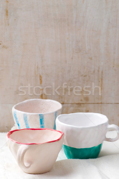 empty ceramic cups on a table Stock photo © zoryanchik