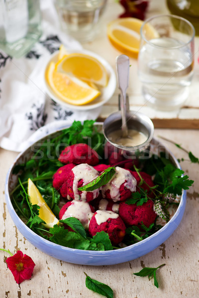 Beet falafel with tahina sauce and green salad  Stock photo © zoryanchik