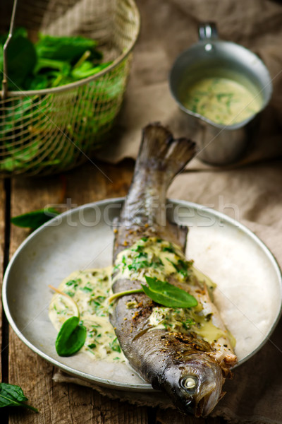 trout stewed with sauce from a sorrel. Stock photo © zoryanchik