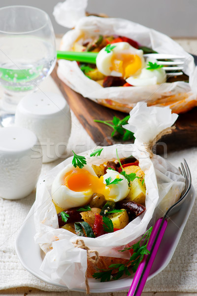 Vegetables with sausages in parchment. Stock photo © zoryanchik