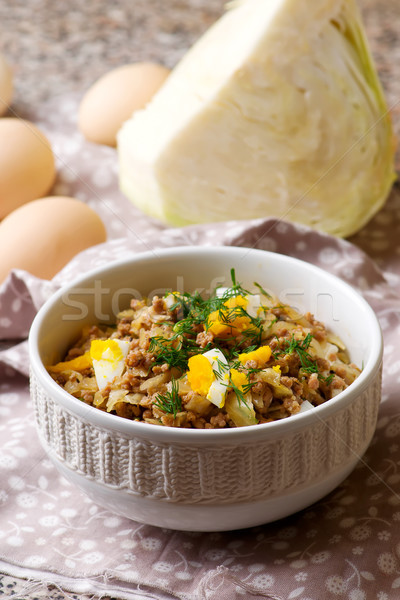 Pie  cabbage stuffing in the bowl. selective focus  Stock photo © zoryanchik
