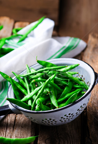 fresh, organic green beans in a vintage colander Stock photo © zoryanchik