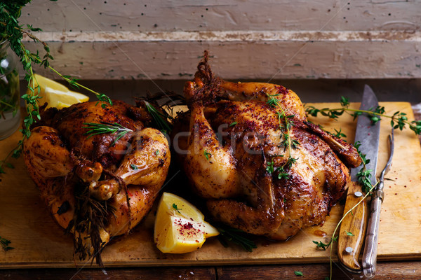 SUMAC ROAST CHICKEN WITH LEMON AND GARLIC. Stock photo © zoryanchik