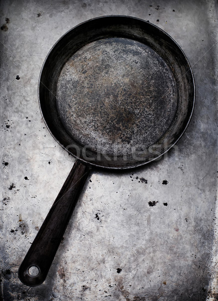 Stock photo: vintage tableware on a metal old background.