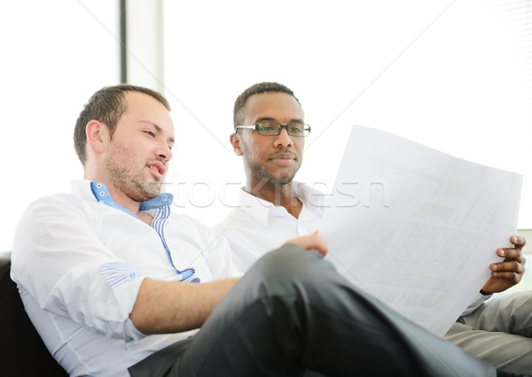 Group of multi ethnic business people at work discussing a project Stock photo © zurijeta