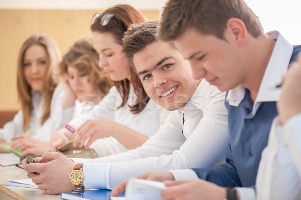 Sorridente escola secundária estudante posando sala de aula educação Foto stock © zurijeta