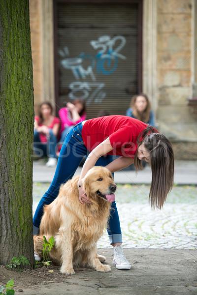 Young female cuddling a retriever Stock photo © zurijeta