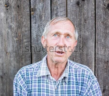 Feliz sorridente mais velho senior homem retrato Foto stock © zurijeta