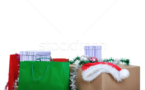 New year and cristmas shopping bags and boxes with santa hat, copy space Stock photo © zurijeta