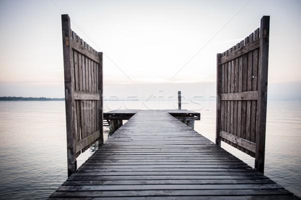 Lac quai eau nuages mer silhouette Photo stock © zurijeta