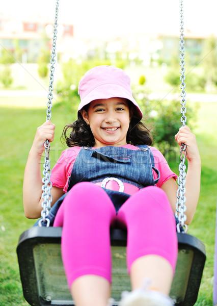 Little girl swinging in park Stock photo © zurijeta
