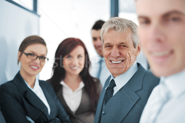 Small business team in the office in front of a whiteboard Stock photo © zurijeta